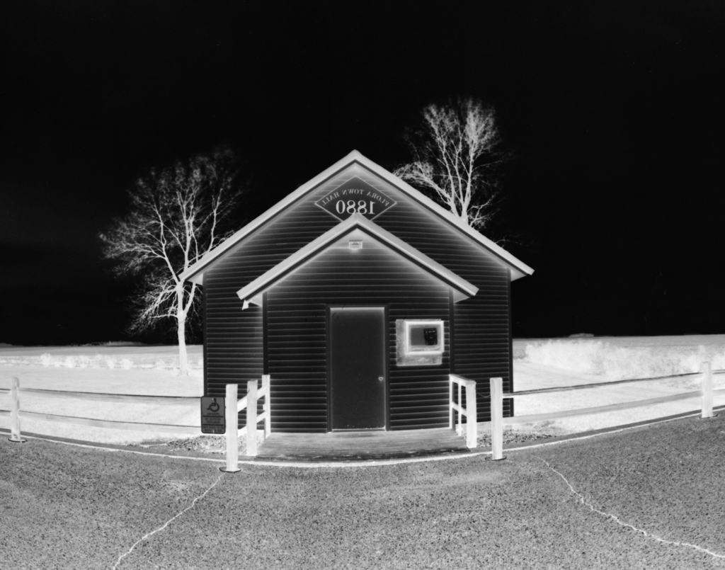 Flora - Approaching: Formal portrait of the Flora Township hall.