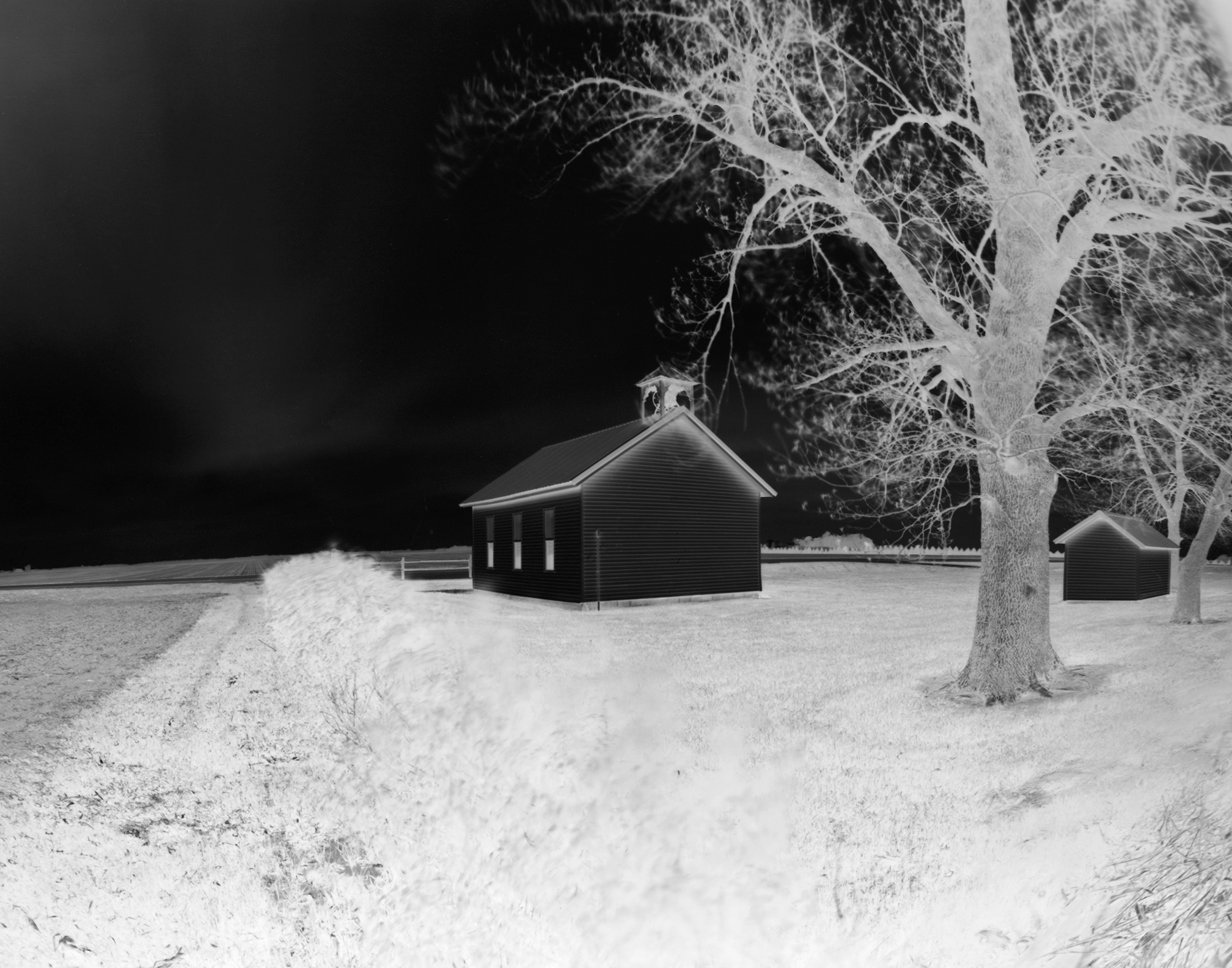 Flora - Back Yard: Photograph of the Flora Township hall and its back yard.