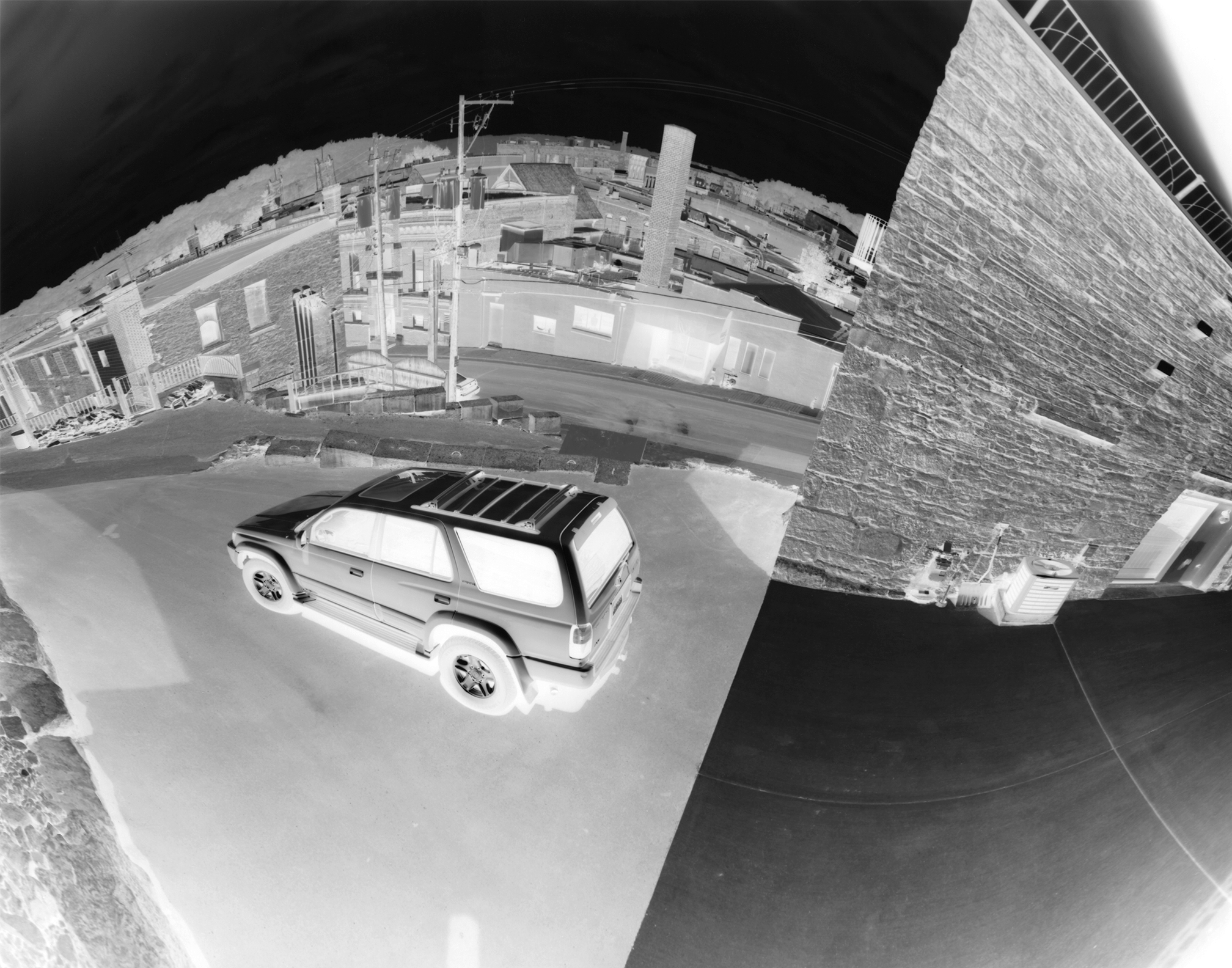Above Town: A car parked in a driveway just above downtown Stillwater.